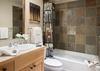 Guest Bedroom 1 Bathroom - Moose Creek 35 - Slopeside Cabin in Teton Village - Luxury Villa Rental