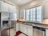 Kitchen - Equipped with a Side-by-side Refrigerator with Ice Maker