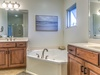 Master en suite with double vanities, garden tub, and walk in shower
