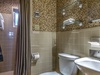 Carriage House Bathroom - Featuring a Walk In Shower & Single Vanity