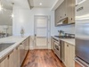 Kitchen - Featuring a Stainless Steel Viking Fridge