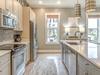 Spacious Kitchen with Mini Fridge and Stainless Appliances