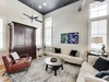 Living Room - Furnished with Two Sleek Leather Couches