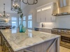 The host will enjoy entertaining in this fully equipped kitchen