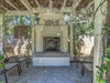 Sit in the shaded loggia next to the fireplace