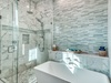 Master Ensuite - Featuring a Soaking Tub & Glass-enclosed Shower