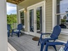 Porch overlooks the private pool