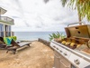 Lanai with Lounge Chairs, Dining Area and BBQ