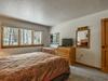 Bedroom with relaxing flatscreen TV
