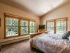 Fall asleep the the spectacular forest view in this bedroom