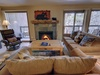 Living room with cozy fireplace and relaxing couches