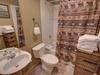 Bathroom with a toiletry shelf