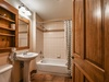 Bathroom with a shower/bath duo