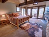 Bedroom with super cool and rustic feel and balcony access