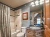 Bathroom with a shower/bath duo