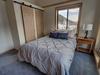 Bedroom with cool barn door closet