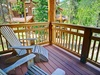 Upper level balcony with lawn chairs and forest view