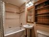 bathroom with a bath/shower duo