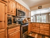 Kitchen with coffee maker perfect for early mornings