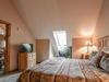 Bedroom with a flatscreen TV