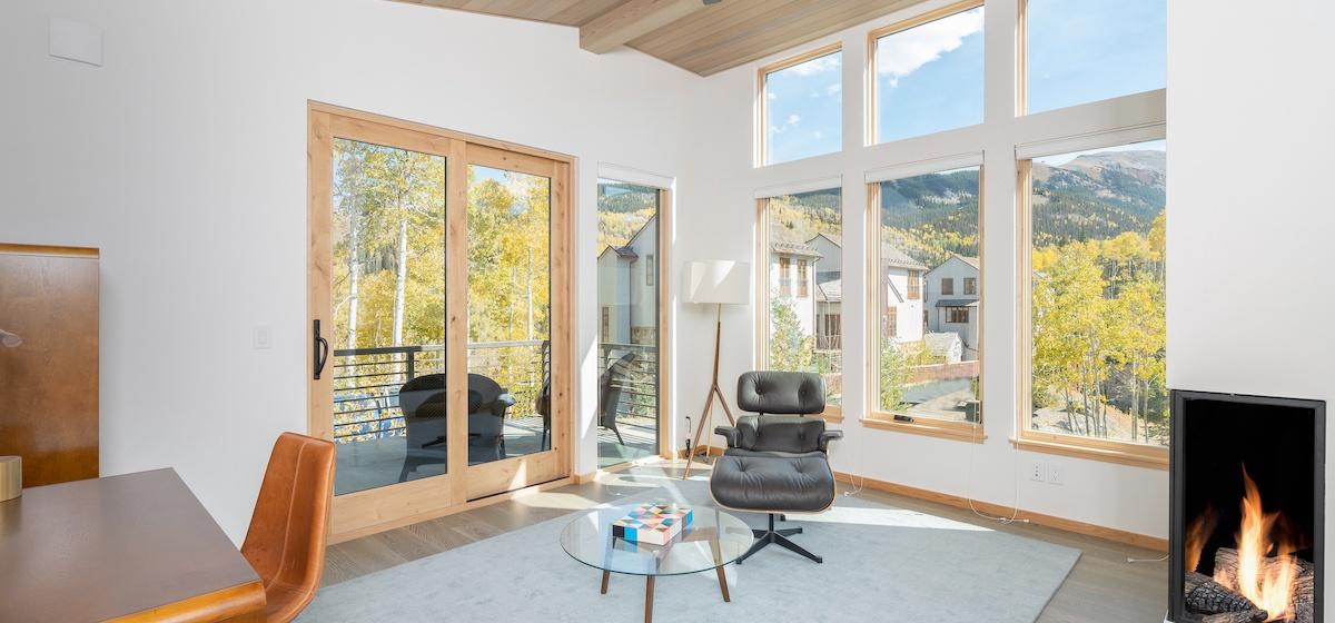 2.06-mountain-village-chalet-cortina-master-suite-office-lounge-V12.jpg