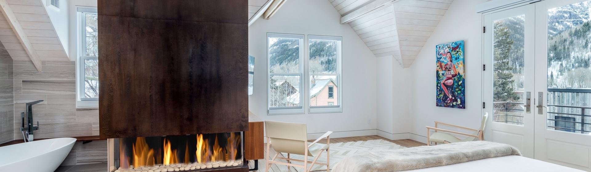 19-Telluride-The-Sunnyside-Master-Bedroom-Bathroom-Fireplace-Web.jpg