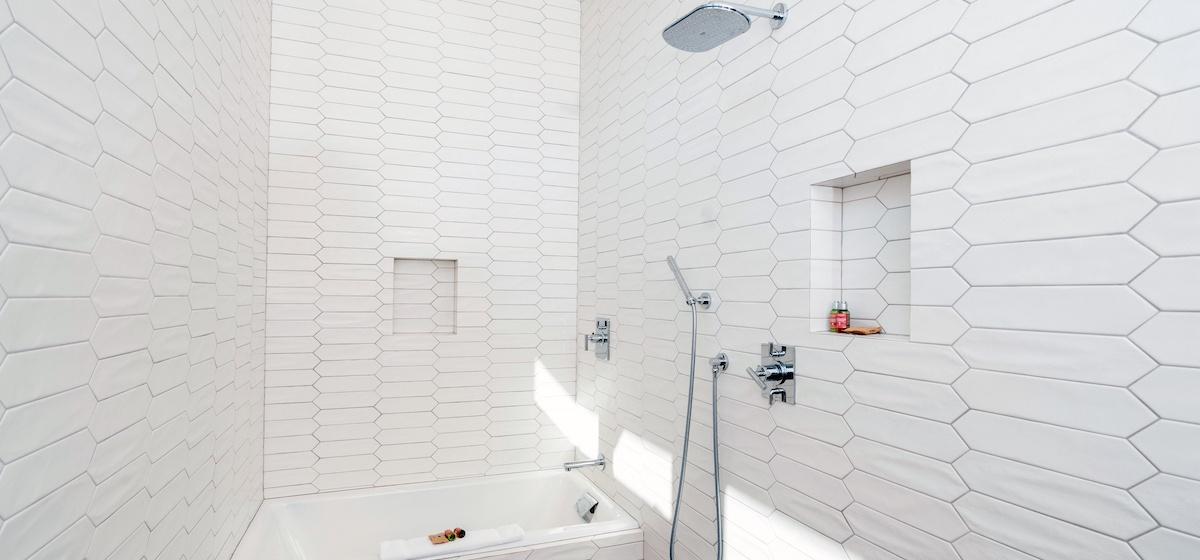 2.10-mountain-village-chalet-cortina-guest-bathroom-1-shower-tub-V12.jpg