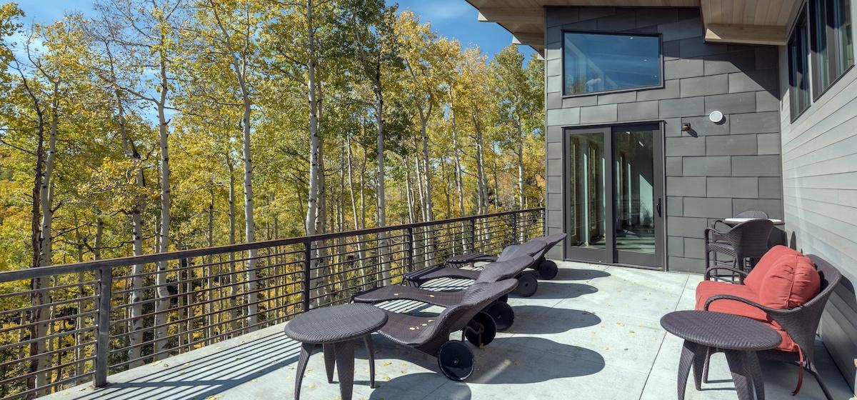 5.02-mountain-village-chalet-cortina-main-floor-deck-seating-V12.jpg