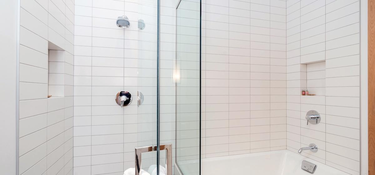 3.05-mountain-village-chalet-cortina-guest-bathroom-2-tub-shower-V12.jpg
