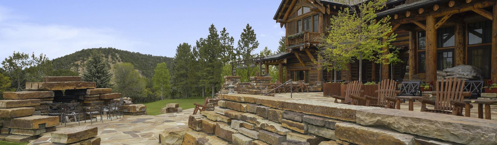 12.3-Telluride-Sleeping-Indian-Ranch-stone-terrace-sitting-area-web.JPG