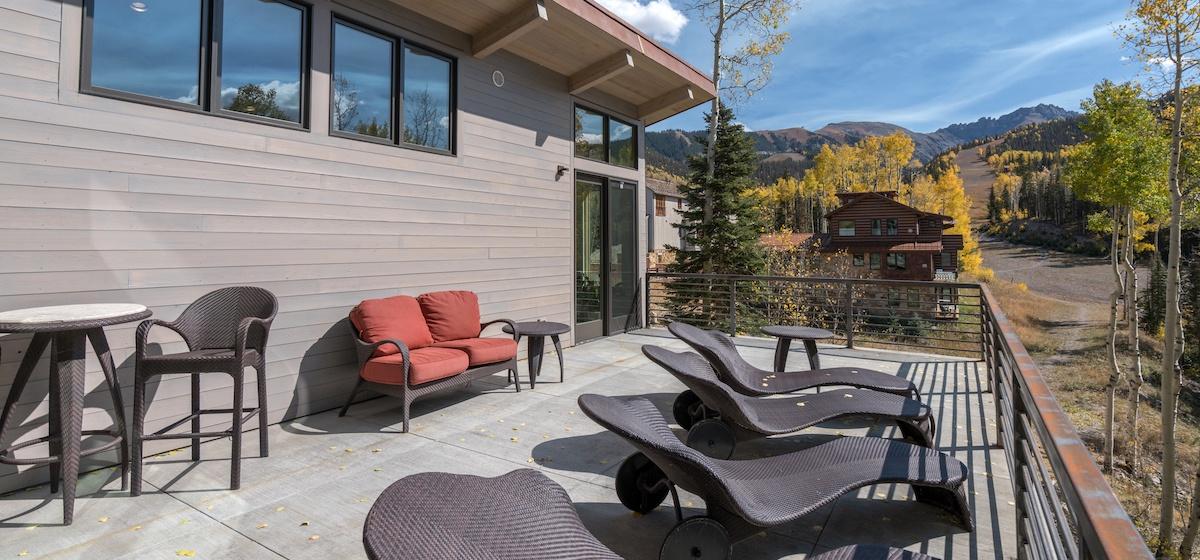 5.04-mountain-village-chalet-cortina-main-floor-deck-seating-V12.jpg