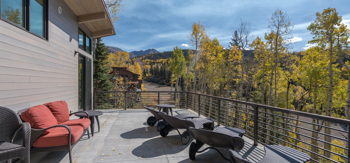 5.01-mountain-village-chalet-cortina-main-floor-deck-seating-V12.jpg
