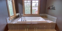 Bathroom with a gorgeous bathtub to relax in