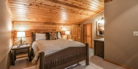 Bedroom with beautiful lighting and amazing vaulted ceilings
