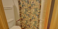 Bathroom with fun shower curtain