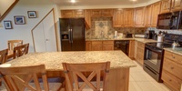 Dining room with extra dining and granite counters