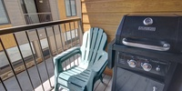 Balcony with private BBQ and lawn chairs