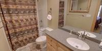 Bathroom with a fun shower curtain