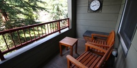 Porch with relaxing wooden chairs