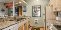kitchen with stainless sink and granite counters