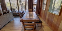 Dining room with beautiful patterned wooden tables