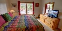Bedroom with flatscreen TV