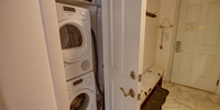 A mudroom with shoe storage and a washer and dryer