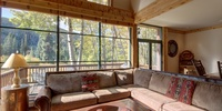 living room with forest view