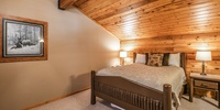Bedroom with a vaulted ceiling