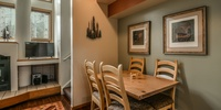 Dining area with wooden table and beautiful view