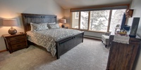Bedroom with comfortable bed and storage