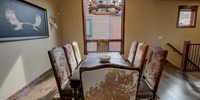 Dining area with beautiful patterned chairs