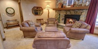 Living room with a cozy warm fireplace