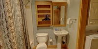 Bathroom with one sink and a bath/shower